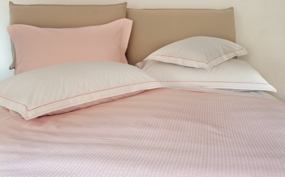"Cotton sheets plain with pink double ""cordonetto"" embroidery.."