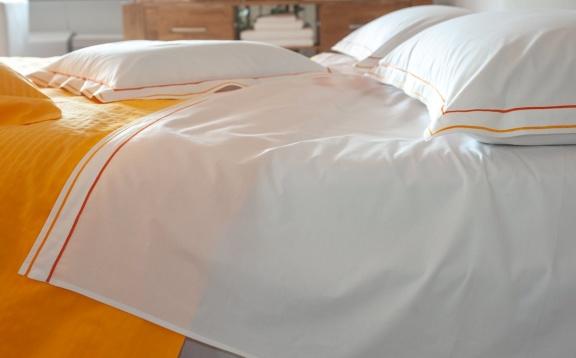 Lenzuola cotone con doppio cordonetto arancio