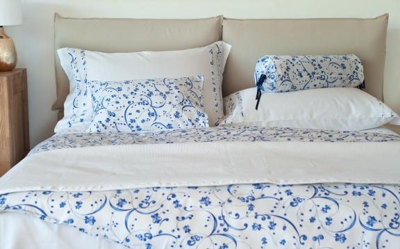 "Sateen sheets plain color with ""Pooq"" applique."