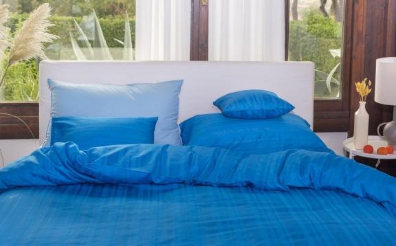 Tess light blue jaquard stripe.